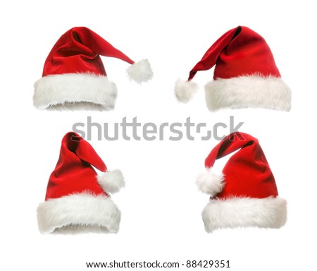 The red hat of Santa Claus in various positions - stock photo