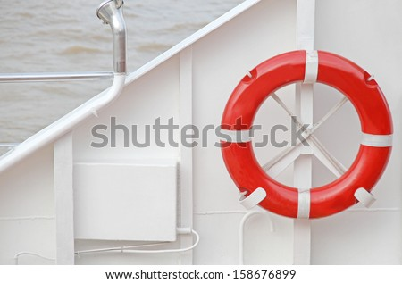 The red lifebuoy on white background of boat.  - stock photo