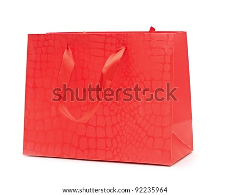 The red package for purchases is isolated on a white background. - stock photo