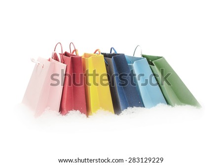 The red, pink, yellow, green and blue gift packages stand on snow, isolated on the white - stock photo