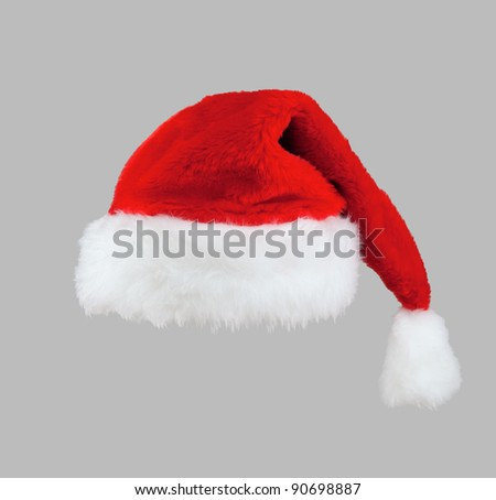 The red Santa Claus hat. Isolated on gray background.