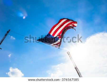The Red, The White, & The Blue - American Flag Flying From Extended Firetruck Ladders