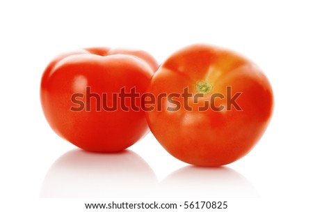 The red tomatoes isolated on white - stock photo