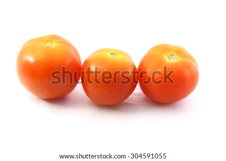 the red tomatoes. it is look so nice and so fresh. this picture is also suitable for advertising