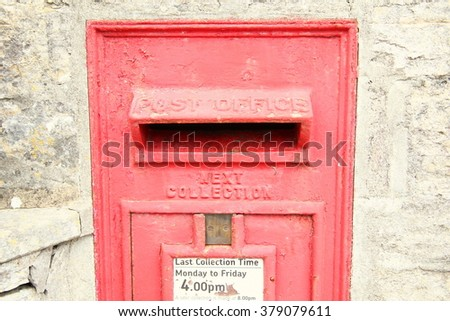 The red traditional classic postbox in the wall represent the postal concept related idea. - stock photo