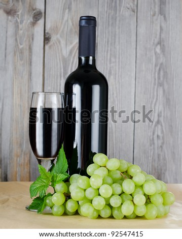 The red wine glass against wooden boards