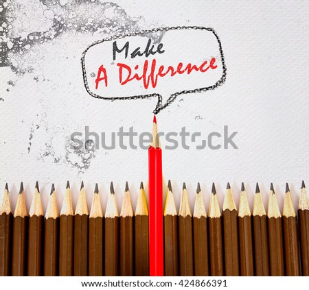 the red wooden pencil arrange on dirt watercolor paper with make a difference concept - stock photo