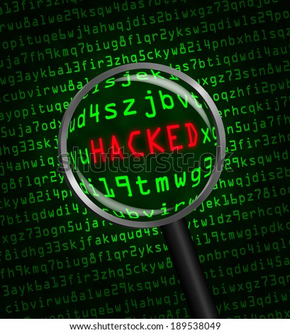"The red word ""HACKED"" revealed revealed in green computer machine code through a magnifying glass  - stock photo"