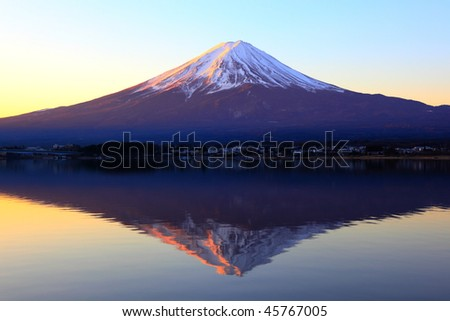 The reddish mountain Fuji and reflection - stock photo
