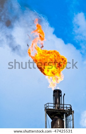 the refinery flare with cloud in background - stock photo