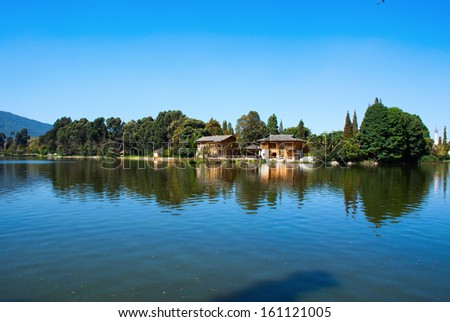 The reflection of forest, pagoda and hut