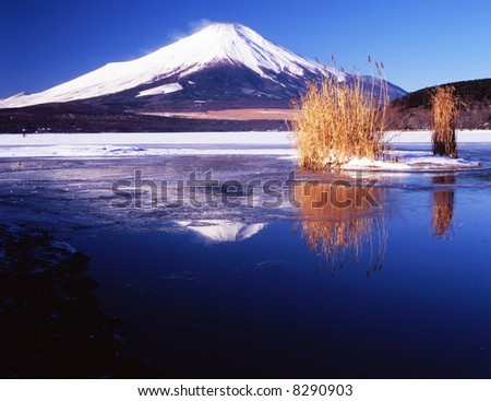 the reflection of Mt,fuji on a lake - stock photo