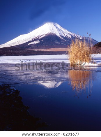 The reflection of Mt. Fuji on a mountain lake - stock photo