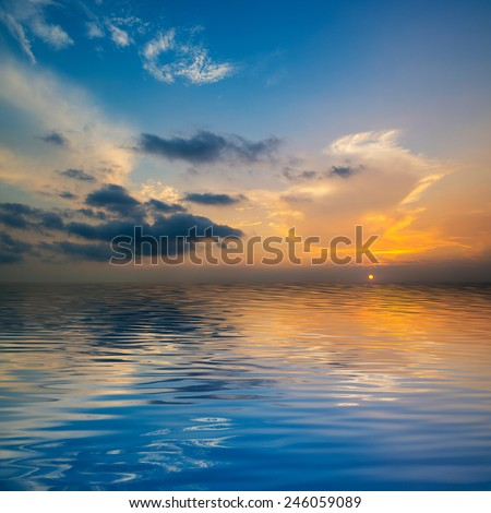 The reflection of the sky on the lake - stock photo