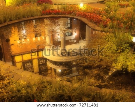 The reflection of the Taipei Story House on the pool in its garden. - stock photo