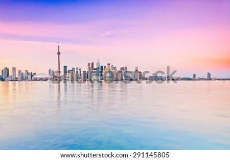 The reflection of Toronto skyline at dusk in Ontario, Canada - stock photo