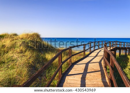 The Regional Natural Park Dune Costiere (Torre Canne): wooden walkway between sea dunes. (Apulia)-ITALY- The park covers the territories of Ostuni and Fasano along eight kilometers of coastline. - stock photo