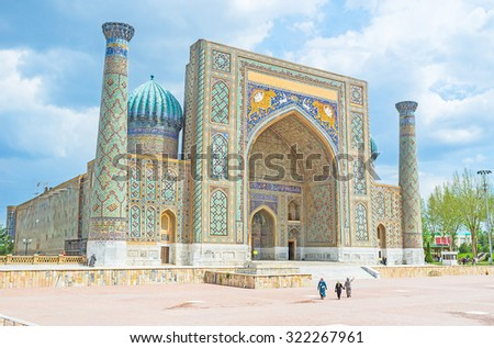 The Registan Square is the best place to discover  the old Uzbek architecture and to enjoy the great mosaic decorations, Samarkand, Uzbekistan. - stock photo
