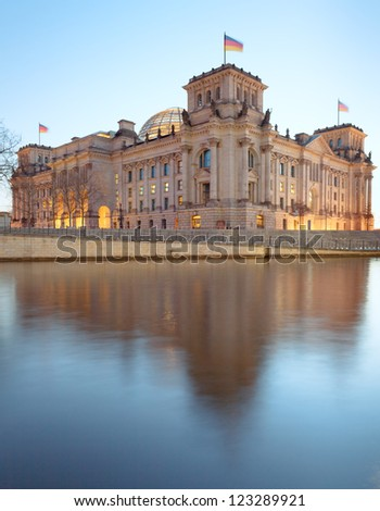 The Reichstag building (Bundestag), famous landmark in Berlin and housing the German Government with spree reflection