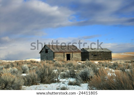 The remains of an old barn on a prairie in Montana - stock photo