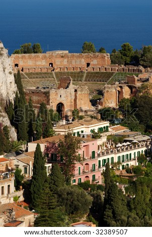 The remains of the ancient Greek Theater, sitting on a hillside overlooking the Mediterranean, Taormina, Sicily.