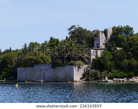 The remains of the castle of Ilovik on the island Petar in Croatia - stock photo
