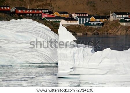 The remains of two icebergs floating near the city of Amassalik, Greenland - stock photo