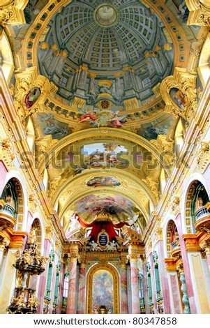 The remarkable trompe l'oeil dome of the Jesuit Church (Jesuitenkirche), a two-floor, double-tower church in Vienna, Austria, influenced by early Baroque principles but remodeled in 1703-1705. - stock photo