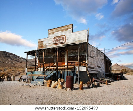 The Remnant Of A Bygone Era, Sunny Skies Over A Dilapidated Building At Rhyolite Nevada, An Abandoned Town Near Death Valley, USA - stock photo
