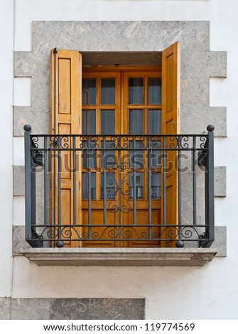 The Renovated Facade of the Old Spanish House with Balcony - stock photo