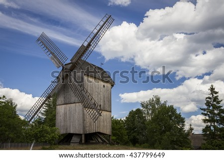 The renovated old wooden windmill