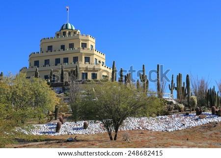 The renovated Tovrea Castle and surrounding cactus garden in Phoenix, Arizona - stock photo