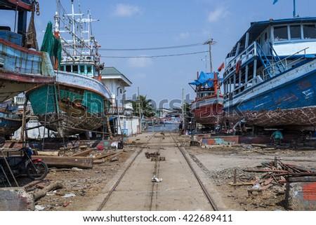 The repairing fishing boat garage at Rayong province Thailand. - stock photo