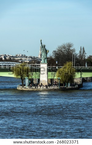 The replica of the Statue of Liberty (1889) on the Ile aux Cygnes (Isle of the Swans) in Paris, France. - stock photo