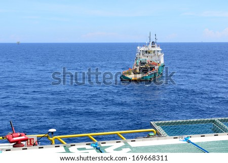 The rescue and supply boat for offshore oil rig operation. - stock photo
