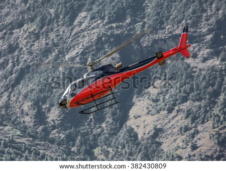 The rescue helicopter on the way from Namche Bazar to Lukla - Nepal, Himalayas