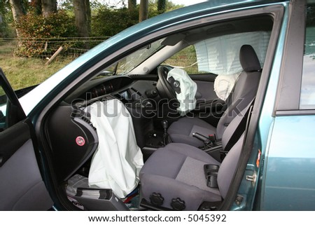 The result of a head on car accident - stock photo
