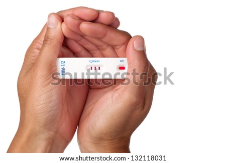 The result of a positive rapid HIV test is held by two female hands. - stock photo