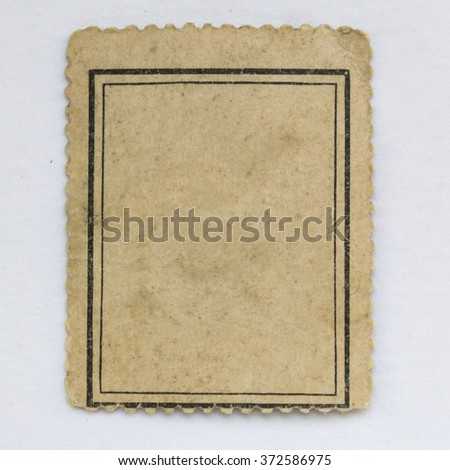 The reverse side of a postage stamp.Old paper texture background. - stock photo