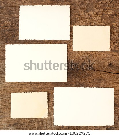 The reverse side of old photos on a wooden background - stock photo