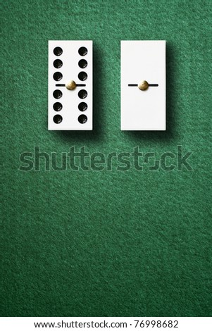 The rich and the poor. Domino game - stock photo