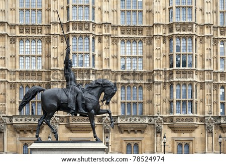 The Richard I Coer de Lion (1189 - 1199) statue with Westminster Palace in the background. London, United Kingdom. - stock photo