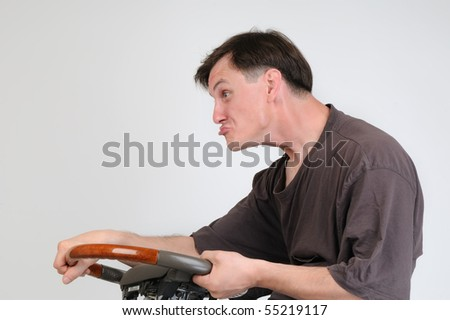 The ridiculous drunk dude with a wheel - stock photo