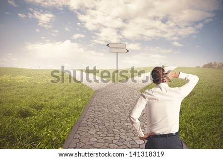 The right destination of a businessman - stock photo