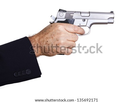 The right hand of a mature adult man wearing a suit, holding a 9mm gun with both hands aiming it to the target. Isolated on white background. - stock photo