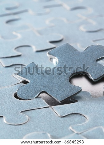 the right jigsaw puzzle to fit in. - stock photo