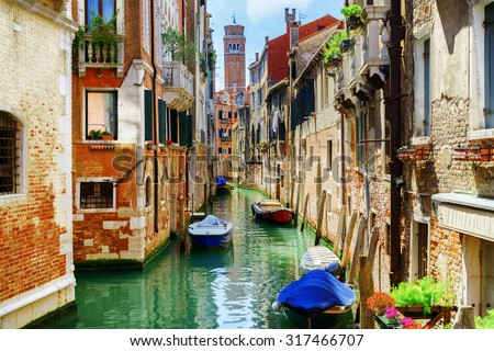 stock photo the rio di san cassiano canal with boats and colorful facades of old medieval houses in venice 317466707 - Каталог — Фотообои «Венеция»