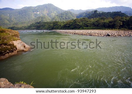 The Rio Quijos flowing through the Amazonian foothills of the Andes in Ecuador - stock photo