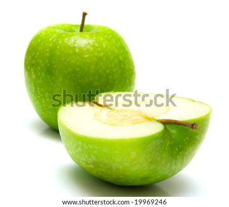 The ripe juicy green apples. Isolation on white.