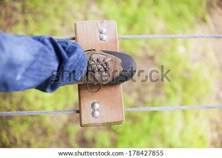 The risk of walking many feet above the ground - stock photo